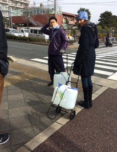 Bringing water for tea to Amae-san's house