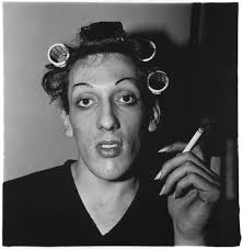 A young man in curlers at home on West 20th Street, 1966.