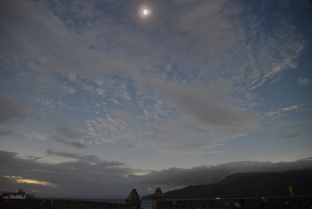 Our view of the March 9 total solar eclipse (9:55 am local time = 7:55 pm on March 8 in New York) from a 16th-century fort on the south side of Ternate. (The fort was built by the Portuguese in 1504 and rebuilt by the Dutch in 1610; it can be seen as a pentagon in Google Earth on the southeast side of Ternate.) All the eclipse phenomena were visible: diamond ring, Baily's beads, prominences (with a particularly bright prominence at the 9 o'clock position) and the corona, but through thin clouds.