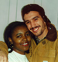 Phillipa Johnson '99 (left) poses with SoCA founder Frank Rosado '96 (right).