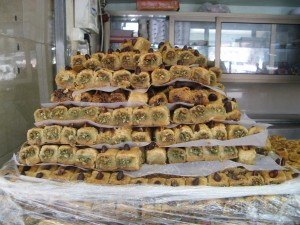 A tower of honey-soaked baklava tempts window-shopping tourists to this pastry shop in Akko.