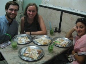 "Mission accomplished in the Old City! Williams students at Zalatimo, the unmarked shop where the eponymous family bakes an Arab confection called mutabbaq (""folded"" in Arabic) from a 150-year-old recipe. Connor and Amy are masking their eagerness to dig into the sugar-drenched layers of phyllo, while Elvira already seems nap-bound after a few sips of minty lemonade."
